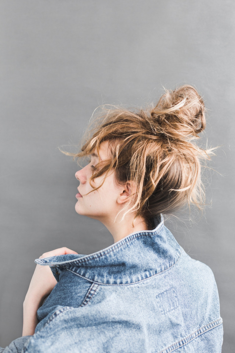 back-view-of-woman-holding-her-denim-jacket-789812-3